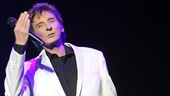 Barry Manilow blows his 