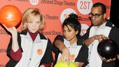 Emily Bergl, Rebecca Naomi Jones and Daniel Breaker practice for the modeling portion of the bowling competition.