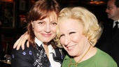 Susan Sarandon and Bette Midler share a hug at the opening night party.