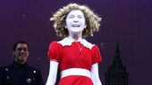 In her signature red dress and curls, Annies title star Lilla Crawford takes her bow.