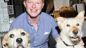 Now that's better! Jesse Tyler Ferguson gets between Annie's canine scene-stealers Sunny and Mikey. See this Broadway fave in the flesh in The Comedy of Errors in Central Park.