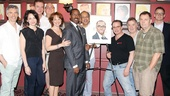 Director George C. Wolfe and cast members from the ensemble drama Lucky Guy join in the merriment as Courtney B. Vance receives his Sardi's honor.