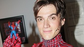The new star shows off his Spidey action figure.