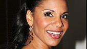 What a night! Lady Day leading lady Audra McDonald flashes a smile.