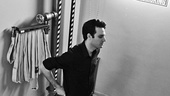 Beautiful star Jake Epstein pauses for a moment of silence in the stairwell before making his entrance.