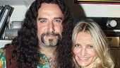 "Adam Dannheisser shows Cameron Diaz the international sign for ""rock"" backstage at Rock of Ages."