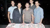 The Four Seasons (plus matinee Frankie!) pose with their show's anniversary cake:
