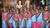 Pals and co-hosts Connie Britton and Carla Gugino get a backstage close-up with the African Children's Choir.