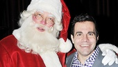 Comedian Mario Cantone must have been on the nice list this year as he gets close with the jolly man himself, Santa Claus.