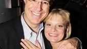 First, Stephen Colbert snuggles up for a photo with his onstage wife, Martha Plimpton...