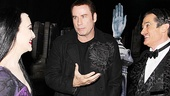 John Travolta chats up The Addams Family's leading couple, Bebe Neuwirth and Roger Rees.
