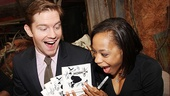 Tony nominees Rory O&#39;Malley and Nikki James are all smiles as they grab hold of several copies of The Book of Mormon cast recording. 