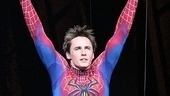 Reeve Carney throws his arms in the air in victory as Spider-Man completes its opening performance.