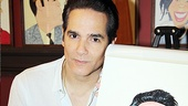 Tony nominee Yul Vazquez poses with his lookalike portrait.