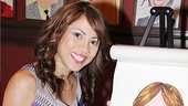 Tony nominee Elizabeth Rodriguez says hello to her caricature.