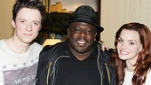 Spider-Man alternate Matthew James Thomas and leading lady Jennifer Damiano sandwich backstage guest Cedric the Entertainer.