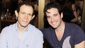 Anything Goes co-stars Adam Godley and Colin Donnell are seated side by side.