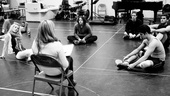 Rehearsal begins as assistant choreographer Jessica Hartman shares notes on the previous day's work.
