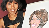 Angela Bassett contemplates changing her hair color so she looks even more like her cute caricature after signing.