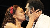 An opening night smooch for good friends Audra McDonald and Norm Lewis at their curtain call.