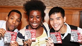 Wallace Smith, Uzo Aduba and Telly Leung show off newly signed copies of the Godspell cast recording.