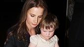 Rachel Griffiths autographs her portrait with the help of her daughter, Clementine Grace.