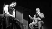 Remy Auberjonois as Howard Wagner and Philip Seymour Hoffman as Willy Loman in Death of a Salesman.