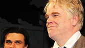 Finn Wittrock looks on as star Philip Seymour Hoffman takes a bow.