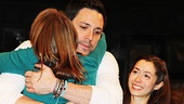 Cristin Milioti smiles wide as Steve Kazee embraces Marketa Irglova, the Once co-composer who created her role of Girl on screen.