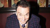 Before unveiling his Sardi's portrait, Spider-Man star Patrick Page poses with a special Green Goblin birthday cake.