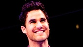 Darren Criss cracks up the audience with witty ad-libs between awards.