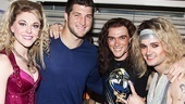 Rock of Ages headliners Ashley Spencer, Justin Matthew Sargent and Jeremy Woodard form a huddle around Tim Tebow.
