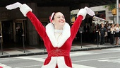 Designed by Pete Menefee, the Rockettes' Red Santa costume was first introduced in 1982. Here Kim Petros shows it off.