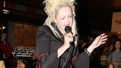Cyndi Lauper treats fans to a mini-performance from on top of the piano.