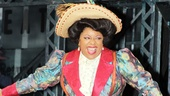 Newsies' new Medda Larkin, LaVon Fisher-Wilson, looks as happy as she is colorful during the curtain call.