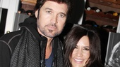 Victor's Cafe manager Monica Zaldivar congratulates Billy Ray Cyrus on his opening night.