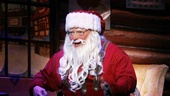Wayne Knight looks just jolly as Santa Claus in Elf.