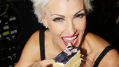 Amra-Faye Wright takes a bite of...herself. We cant say we blame her! 