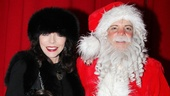 Ho-ho-holy smokes! The stunning Joan Collins takes her granddaughter Eva backstage to meet Santa (Eddie Korbich) at A Christmas Story, The Musical.