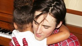 Aww! Reeve Carney gives a hug to Jamie Foxx's four-year-old daughter, whose hero is Spider-Man.