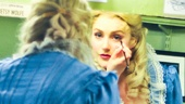 Now in full Rosa Bud couture, Betsy Wolfe puts the finishing touches on her makeup.