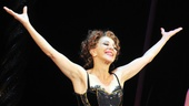 After her acrobatic performance, stage and screen star Andrea Martin (Berthe) takes in the energy of the cheering crowd while Matthew James Thomas looks on.