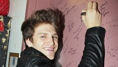 Keegan Allen is the latest star to put his autograph on the wall backstage at Spider-Man.