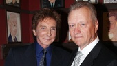 Barry Manilow celebrates his Sardi's honor with the restaurant's owner, Max Klimavicius.