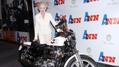Taylor poses with Ann Richards specially made Texas motorcycle. 