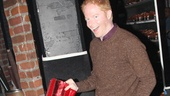 Broadway vet Jesse Tyler Ferguson plays around backstage with the show's title footwear.