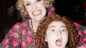 I love you, Miss Hannigan? Annie stars Jane Lynch and Lilla Crawford play around backstage after the show.