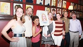 The cast of Vanya and Sonia and Masha and Spike and playwright Christopher Durang surround Nielsen for a group shot.