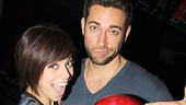 First Date stars Krysta Rodriguez and Zachary Levi show off their big red ball.
