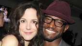 Mary-Louise Parker grabs an adorable photo op with Taye Diggs at the party.